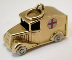 A 1955 18ct Gold & Enamel Ambulance Charm Opens to a Red Enamel Heart Inside.