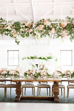 Gorgeous blush El Chorro wedding, in Paradise Valley, Arizona. Light chiffon dress, and coral, pink and white peonies bouquets. Floral archway at the ceremony, and a modern design in petals for the runway. And hanging florals and greens at the reception.