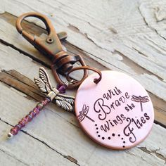 "What a lovely sentiment to see when you pick up the keys and head out for the day . ""With brave wings she flies"" copper custom name bird pink crystal Keychain silver crystal hand stamped handstamped key chain dragonfly angel Dragonfly Jewelry, Dragonfly Art, Dragonfly Quotes, Dragonfly Symbolism, Dragonfly Tattoo, Stamped Jewelry, Metal Jewelry, Silver Jewelry, Silver Ring"