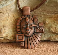 Hand sculpted OOAK Polymer Clay Face Pendant by FaceARTifacts