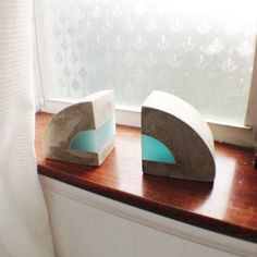 Modern Concrete and resin bookends. Set of 2 by erinalthea on Etsy https://www.etsy.com/listing/177927472/modern-concrete-and-resin-bookends-set