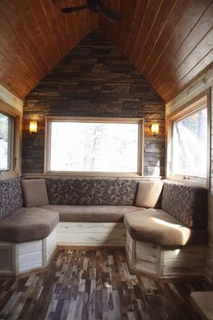 Explore simple bliss with this gorgeous stone cottage on wheels: Its fireplace is simply amazing
