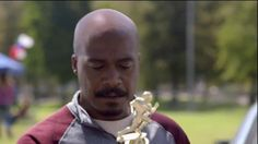"A father and his son are walking back to their 2016 Kia Sorento after a pee-wee football game. Before they arrive at the vehicle, the father, played by Marlon Young, asks to see the boy's trophy. An inner monologue commences. ""A participation trophy. But, we won every game..."" The father doesn't think that his son's team should be given the same trophy as all the other teams. What's next? Will games start ending with hugs rather than handshakes? Not on his watch. He breaks off the…"