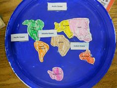"""We glued the 7 continents and 4 oceans onto a painted paper plate. The best part was singing """"We've got the Whole Globe in Ou..."""