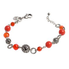 """Tendril-Orange Bracelet Just add color: Playful, lithe scrolls are accented by colorful faux gemstones in this stunning, earthy piece. Tendril Collection  •  Silver tone  •  7.5"""" length + 1"""" extender  •  Lobster clasp  https://myfashions.graceadele.us/GraceAdele/Buy/ProductDetails/11072"""