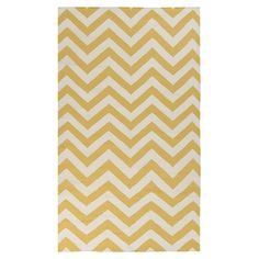 Showcasing preppy chevrons in a gold hue, this hand-woven wool rug creates a sunny focal point for your living room or master suite.   Pr...