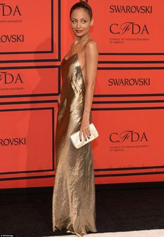 There is nothing like a slip dress,,,unless it is a metallic bronze slip dress as worn by Nicole Richie at CFDA...she killed it!!