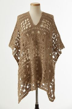 Create this elegant crocheted poncho pattern by working from the bottom up using a lace pattern.