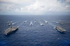 PHILIPPINE SEA (Sept. 23, 2016) USS Ronald Reagan (CVN 76) & USS Bonhomme Richard (LHD 6) lead formation of Carrier Strike Group Five & Expeditionary Strike Group Seven ships including, USS Momsen (DDG 92), USS Chancellorsville (CG 62), USS Stethem (DDG 63), USS Benfold (DDG 65), USS Curtis Wilbur (DDG 54), USS Germantown (LSD 42), USS Barry (DDG 52), USS Green Bay (LPD 20), USS McCampbell (DDG 85), as wells as USNS Walter S. Diehl (T-AO 193) at end of Valiant Shield 2016.