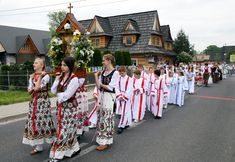 Young people in traditional attire take part in a Corpus Christi procession in Witow, Poland. CNS photo/Grezegorz Momot, EPA