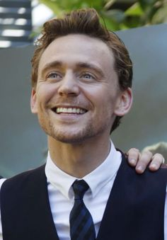 Tom Hiddleston, my goodness that beautiful face<--- I think he looks his best like this, genuinely happy.