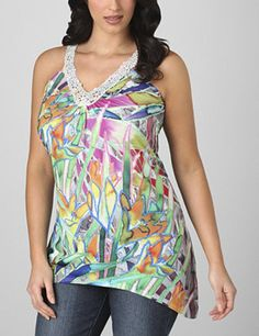 Put a little kick in your look with this bold and colorful tank. V-neckline is trimmed with contrast floral lace. Tunic length falls to longer points on either side, making this a fabulous look to layer. Sleeveless. Available in misses sizes and plus sizes. fashionbug.com