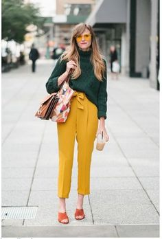 Street style at New York Fashion Week spring Mustard yellow pants with green sweater and orange suede sandals Yellow Fashion, Colorful Fashion, Trendy Fashion, Fashion Outfits, Fashion Ideas, Mustard Fashion, Vintage Fashion, Fashion Trends, Color Blocking Outfits