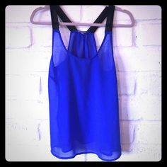 Charlotte Russe Small Cobalt Blue Sheer Tank The cute cobalt blue tank is completely sheer. It has black straps that are also sheer. It's a gorgeous, unique color that is so flattering on all skin tones. Excellent condition. Charlotte Russe Tops Tank Tops