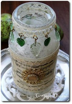 Altered jar using lace, sheet music, leaf dangles, and broken pieces of jewelry. Diy Bottle, Wine Bottle Crafts, Mason Jar Crafts, Mason Jar Diy, Bottle Art, Altered Bottles, Recycled Bottles, Vintage Bottles, Bottles And Jars