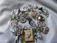 wicked the musical OZ  charm bracelet reserved for by TheMeltonPot, $37.00
