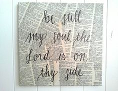 This 12 by 12 canvas features the handlettered words be still my soul the Lord is on thy side on old dictionary pages. This is the perfect accent for your kitchen, bedroom, sitting room etc.