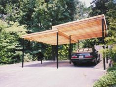 Comment: I love this stucture / Carport; Steel Beams and slatted wood roof;
