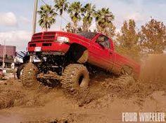 Muddin' Red Lifted Dodge Ram