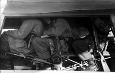 Fallschirmjager packed into a DFS-230 Assault Glider. Of note are weapons carried; MG 34, MP 40 and Kar 98K.