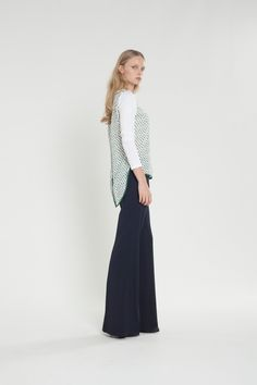 Featuring contrast sleeves and binding, a pointed split back hem and wide neckband, this piece can be dressed up for a smart yet easy evening look. #fashion #top #splitback