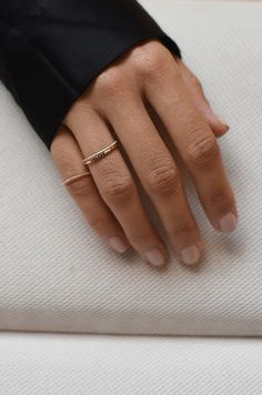 Mejuri 14k solid gold stackable rings with black diamonds.