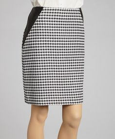 A classic, black-and-white houndstooth pattern combines with side leather panels for a modern take on sophistication. Features