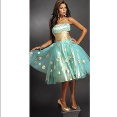 Prom Dress Jovani Short Prom Dress, Turquoise w| Gold Polka Dots. Size 6, but taken out an inch. Worn only once. *150 but willing to go lower Jovani Dresses Strapless