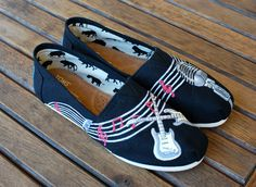 These custom hand painted black canvas classic toms feature music notes, electric guitars and a vintage microphone. These painted toms are the perfect music themed shoes. This order is customizable as