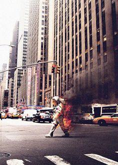 LOST AUSTRONAUT. On fire. Burning. City walk.