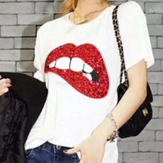 The Jolie Embellished T-Shirt restocking Popular & trendy sequin embellished red lip tee. Cotton blend with round neck & short sleeve. Close snug fit true to size. For looser fit go up 1-2 sizes. See size chart last pic. Go ahead, be unique & wear this sassy, sexy & stylish tee! 💕Per PM & my closet, all sales are final. Please ask questions, if not in description, prior to purchase. I inspect & photograph all items before shipment. My goal is making customers happy with 5⭐️service!💕…