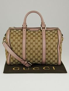 The Gucci Beige/Pale Pink GG Canvas Medium Joy Boston Bag w/ Shoulder Strap is big enough for all that we need to carry. This sleek bag features durable GG canvas with a gorgeous pale pink leather trim. This bag comes with a long detachable shoulder strap for those none toting days. A sophisticated bag with understated style for everyday wear. Retail price is $1180.