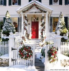 White Christmas House With Decorations Outdoor Christmas Decoration Ideas. Beautiful, traditional Colonial chrismas decor from picket fence gate to column portico and wreaths in every shuttered window. Christmas Porch, Merry Little Christmas, Outdoor Christmas Decorations, White Christmas, Christmas Lights, Christmas Holidays, Christmas Wreaths, Christmas Entryway, House Decorations