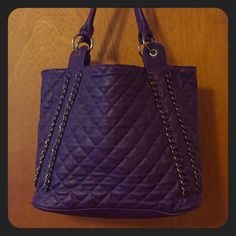 Quilted Plum Bag  Barely used. This deep plum colored shoulder-bag is great for work or play and will complement your fall and winter wardrobes. It has one zip pocket on the outside. Inside is snap closure with 2 small zip pockets and an open pocket between on one side. The other side has 2 open pockets. I love this bag because it easily holds file folders and a notebook. Comment with any questions! Bags Shoulder Bags