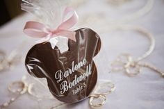 Edible escort cards can double as favors – unless your guests eat them first! #chocolate #MickeyMouse #favors