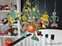Cute robot mobile for a little boys room.
