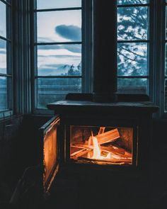 Rainy days and wood stove fires 🔥 Photo by Share your story: Cozy Cabin, Cozy Cottage, Destinations, Destination Voyage, Cabins And Cottages, Patio Chairs, Swing Chairs, Eames Chairs, Adirondack Chairs