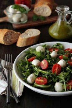 Tomato and Mozzarella Salad with Basil Vinaigrette - A simple salad of arugula, tomatoes, and tomatoes drizzled with a fresh basil vinaigrette. Click through for recipe!