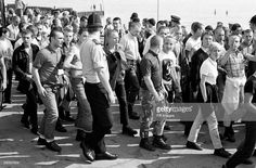 Skinheads storm the seaside town of Southend-on Sea. Police with dogs herded the London skinheads out of the town and escorted them to the station to catch special trains home. Get premium, high resolution news photos at Getty Images Essex Police, Skinhead Boots, Police News, Seaside Towns, Psychobilly, Fred Perry, Childhood Memories, Punk, Culture