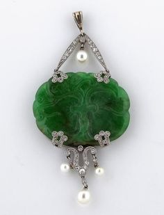 A belle époque jadeite jade, diamond and cultured pearl pendant, circa 1910, French. Centring an oval-shaped carved jadeite plaque;  with French assay and maker's mark; mounted in platinum.