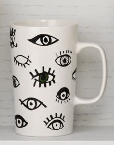 Ceramic coffee mug with hand-drawn eyes that create a unique pattern. #Starbucks #DotCollection