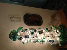 My version of a St. Patrick's tree. The old photo and vintage cut glass and Waterford with a touch of Irish crochet work. Blending of the old and new.