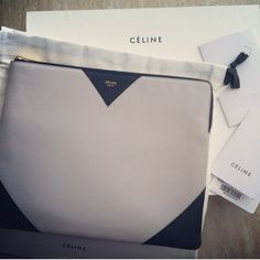 "NWT!Celine Cloud Leather Clutch Authentic leather Celine clutch! Color is ""Cloud"", which is navy blue and light gray. Smooth dual tone leather. Zip closure with gold tone logo hardware. Logo stamped front. Supple leather lining. Made in Italy. Brand new, never used. Minor mark on ""I"" in Paris stamping. Comes with dust bag, tags and original box. No trades! Celine Bags Clutches & Wristlets"