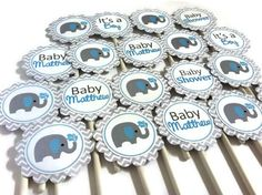 What a classic theme for a baby boy shower: Elephant! These are a set of cute grey Elephant with blue striped ear Cupcake Toppers in white and gray Chevron. They are personalized for your party with t