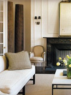 loving a black stone fireplace with elegant neutrals