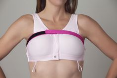 Our Implant Stabilizer Band is the ideal accessory for women undergoing breast augmentation or reconstruction. Constructed using a smooth nylon/Lycra® fabric to minimize irritation, the adjustable velcro straps fit busts of all sizes. The thin strap is easy to hide under clothing making recovery comfortable and discreet. For the active woman, these bands provide the stabilization needed to exercise safely after surgery. It is perfect to pair with the Elizabeth Pink Surgical Bra®, as shown…