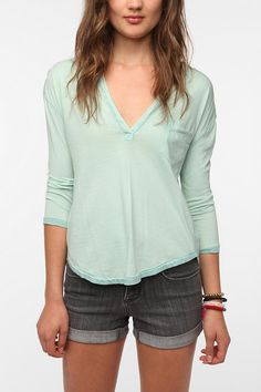 Urban Outfitters Ecote Washed Split Neck Henley Tee comes in green, black, and pink