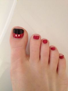 Super easy Mickey mouse pedicure idea! Red, black, and white nail polish is all you need. You could do a matching manicure too!