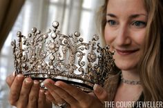 Helen Molesworth of Christie's displays the Poltimore Tiara ahead of its sale in London, 13 May 2006; the tiara, which belonged to Princess Margaret, sold for $1.7 million at auction