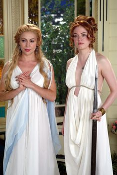 Phoebe & Paige as Goddess's goddess of love and war next to each other.